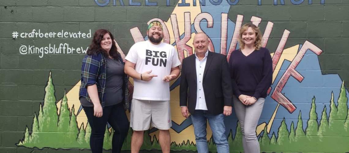 From L to R: KBB Brewing Partner Jessica Atkinson, KBB Owner Dustyn Brewer, Habitat Executive Director Rob Selkow, and Habitat Operations Manager Nicole June